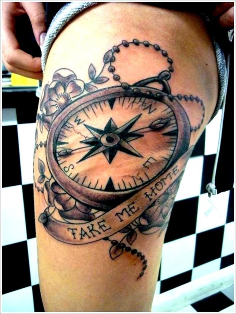 Compass tattoo design on thigh