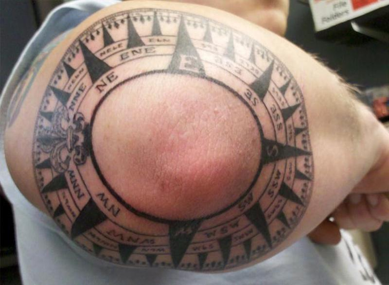 Compass tattoo on elbow 2