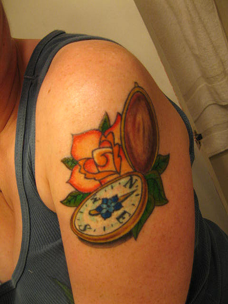 Compass tattoo on man biceps
