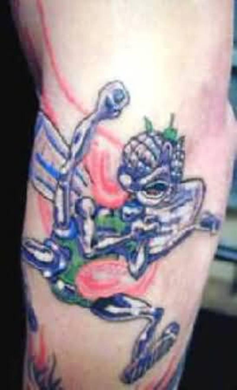 Cool alien tattoo on leg