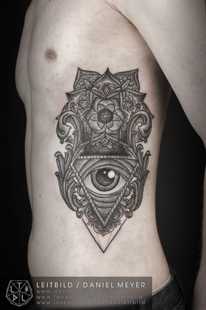 Cool black grey patterns witn eye tattoo on ribs by daniel meyer
