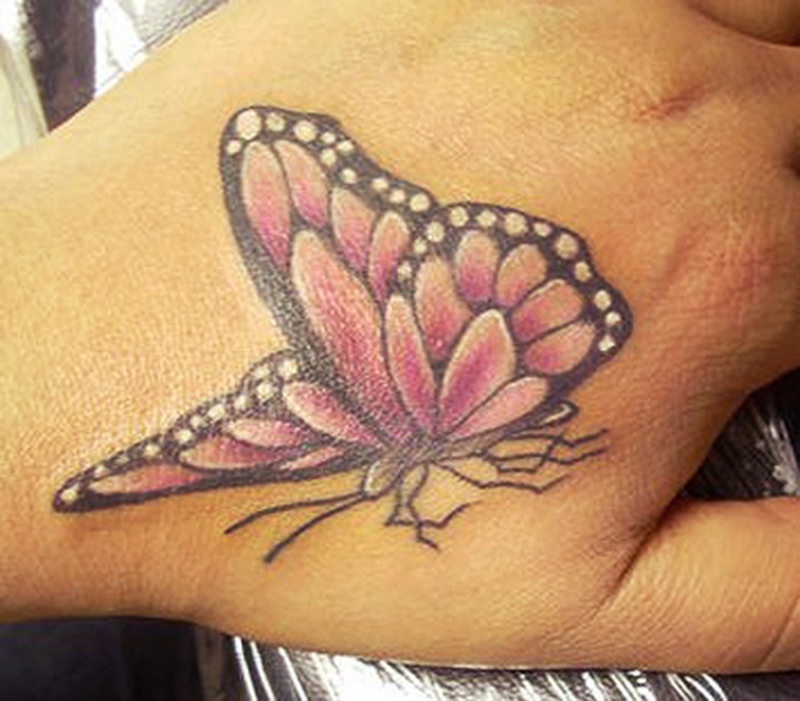 cool butterfly hand tattoo design tattoos book. Black Bedroom Furniture Sets. Home Design Ideas