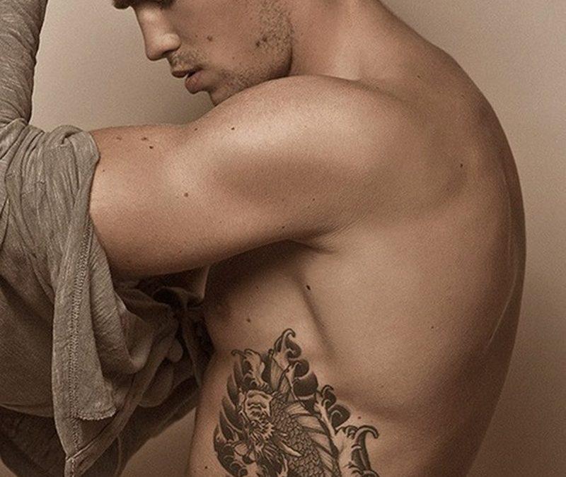 Cool fish tattoo on rib for men