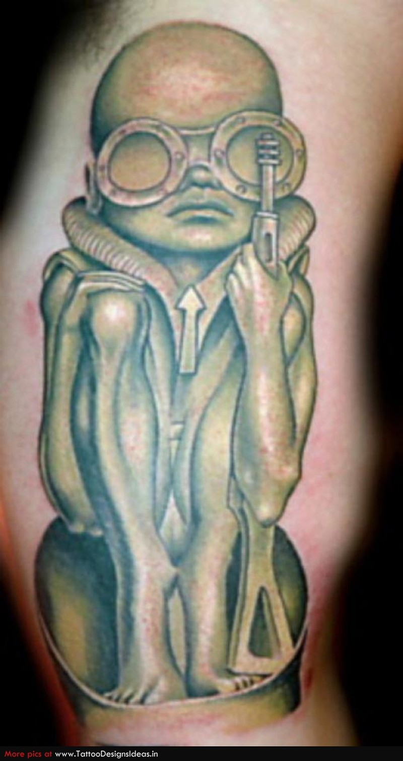 Cool green color alien tattoo
