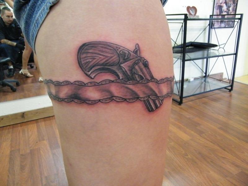 Cool misc garter with gun tattoo design