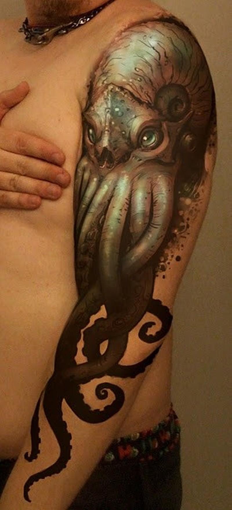 Cool realistic looking octopus tattoo on arm