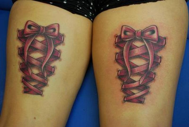 Corset tattoo design on thigh