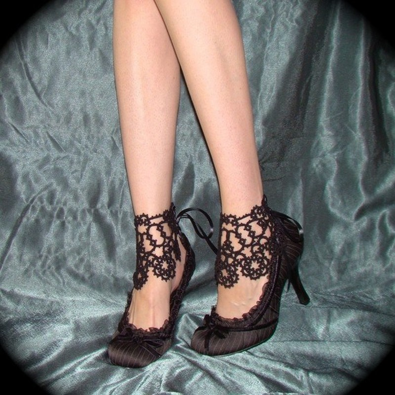 Corset tattoo on ankles