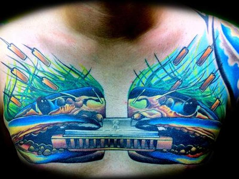 Crabs with mouth organ tattoo on chest