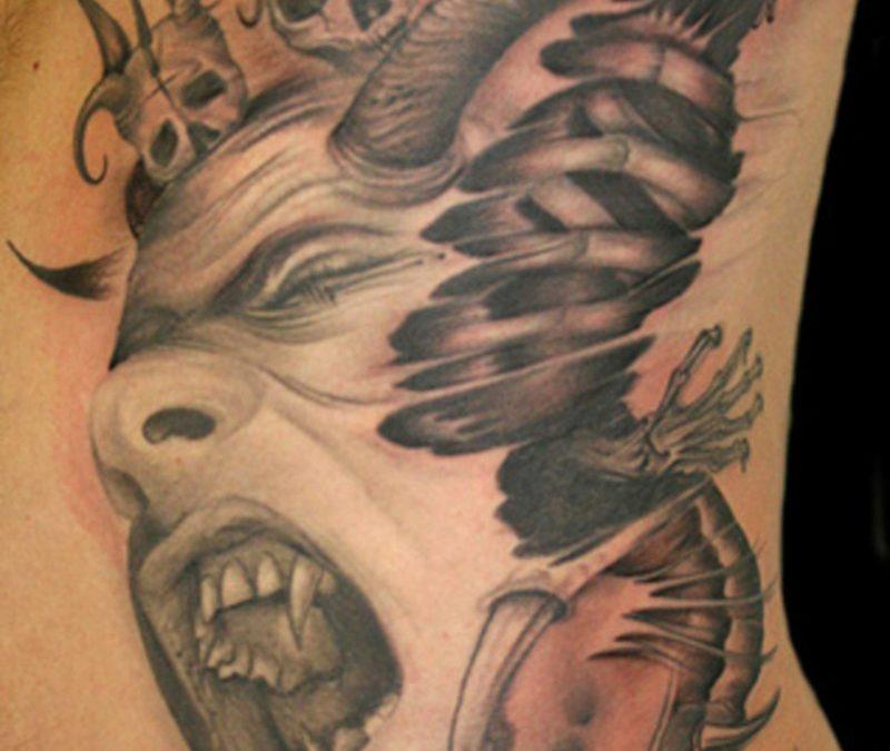 Crawling alien tattoo on rib side