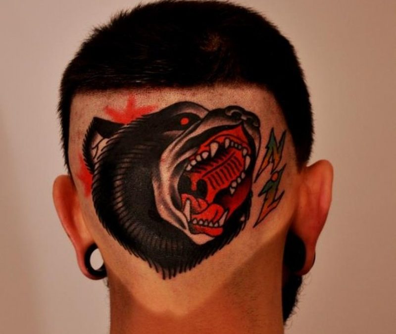 Crawling animal face tattoo on back head