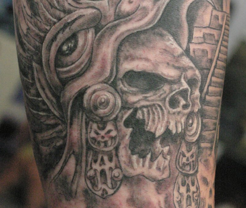 Crawling aztec skull tattoo