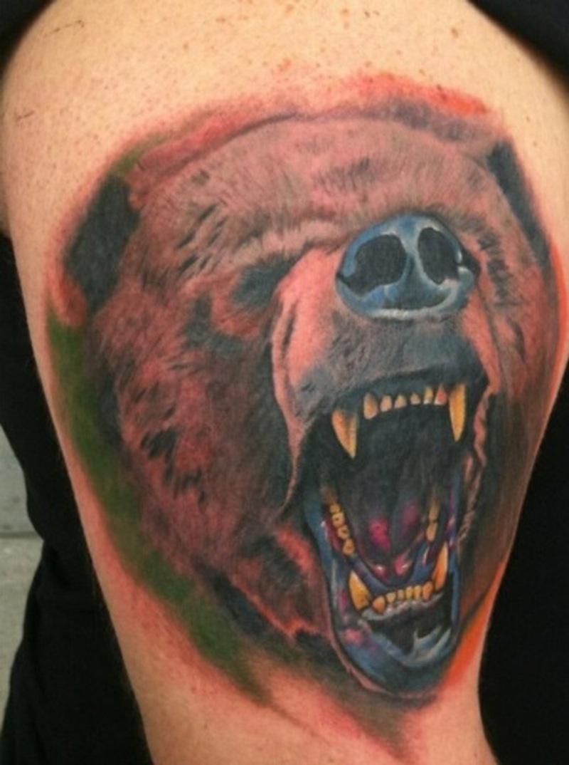 Crawling bear face tattoo on biceps