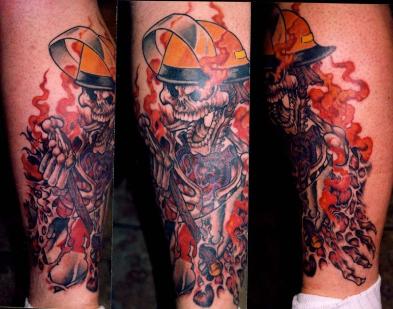Crawling firefighter skull tattoo design