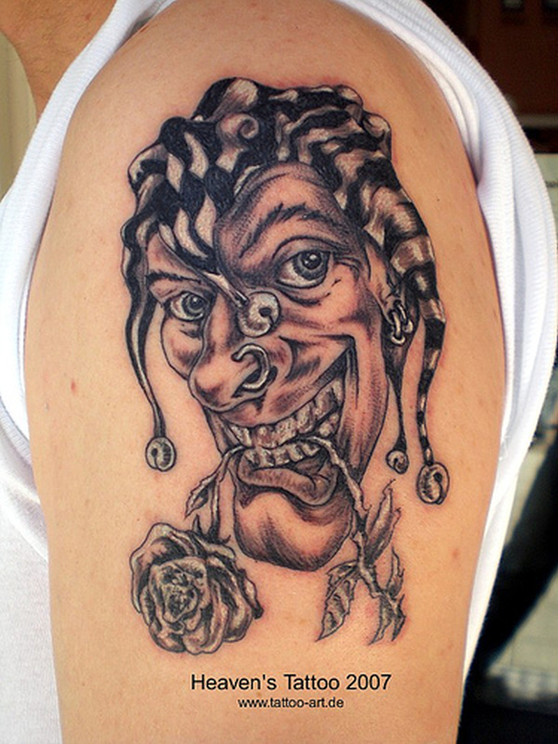 Crazy joker clown tattoo on shoulder