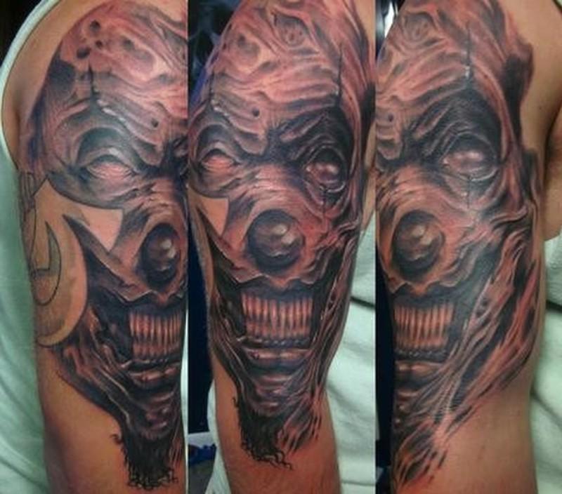 Crazy spooky clown tattoo on arm