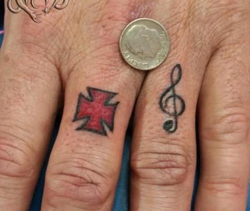 Cross n music tattoo on finger