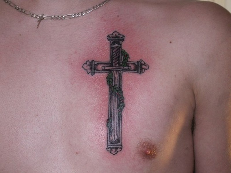 Cross tattoo with a sword in the middle
