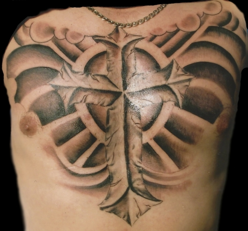 Cross wings tattoo on chest