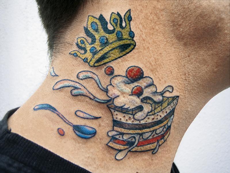Crown cake tattoo on neck