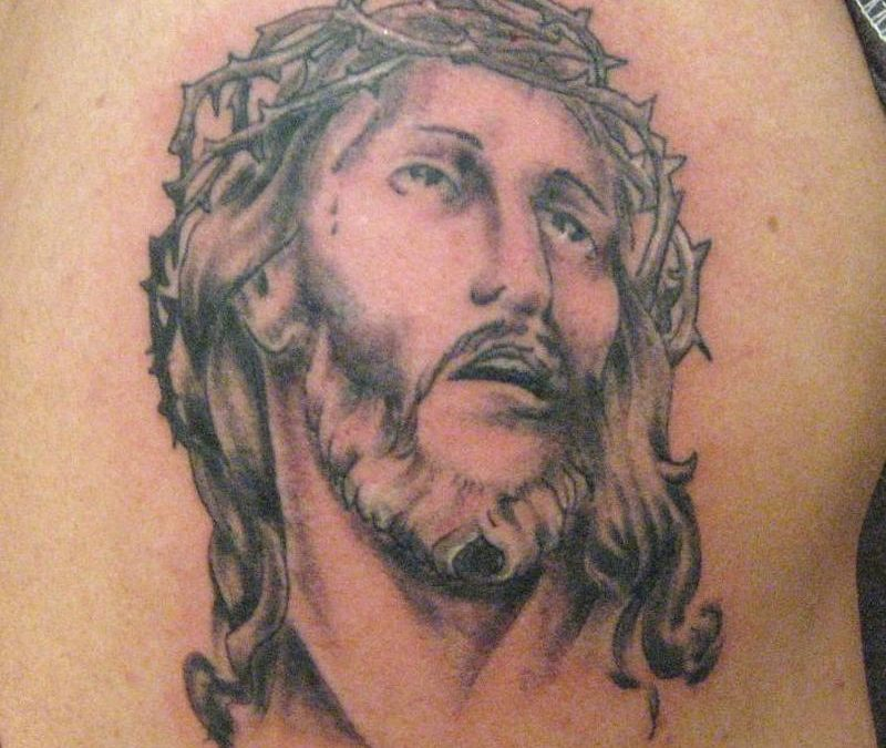 Crown of thorns jesus head tattoo on back