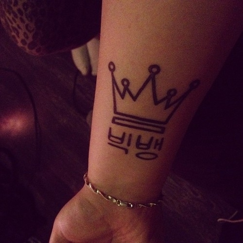 Crown outline tattoo on wrist