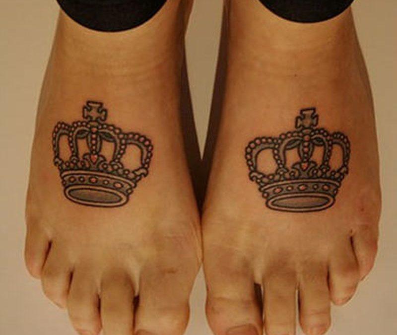 Crown tattoo design on feet