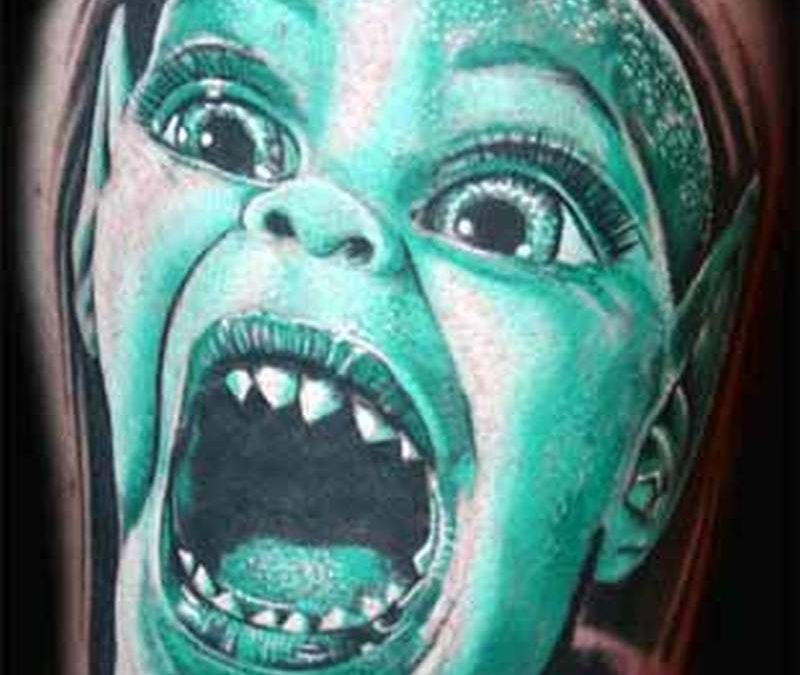 Crying alien tattoo
