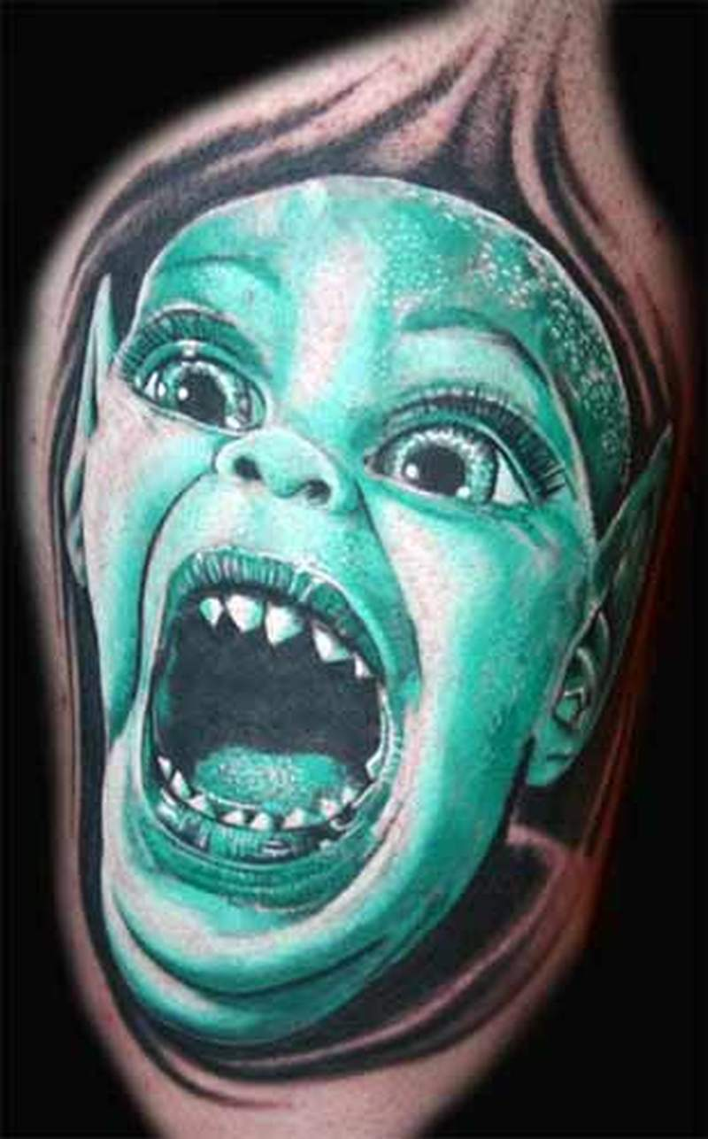 Crying alien tattoo