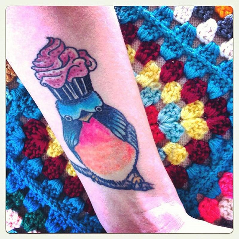 Cup cake on bird head tattoo image