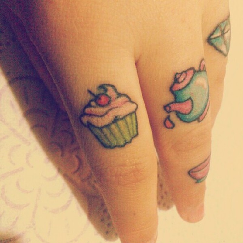Cup cake tattoo on finger