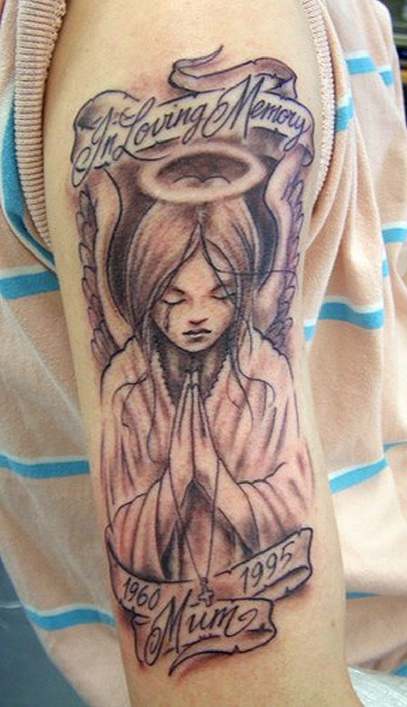 Cute angel tattoo on shoulder