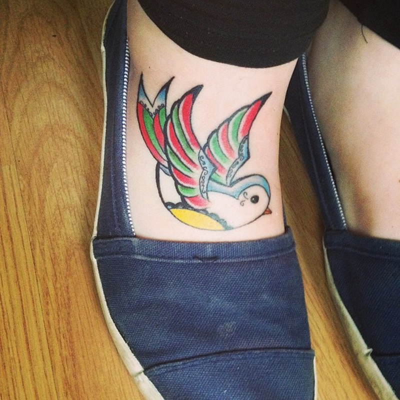 Cute bird foot tattoo for women