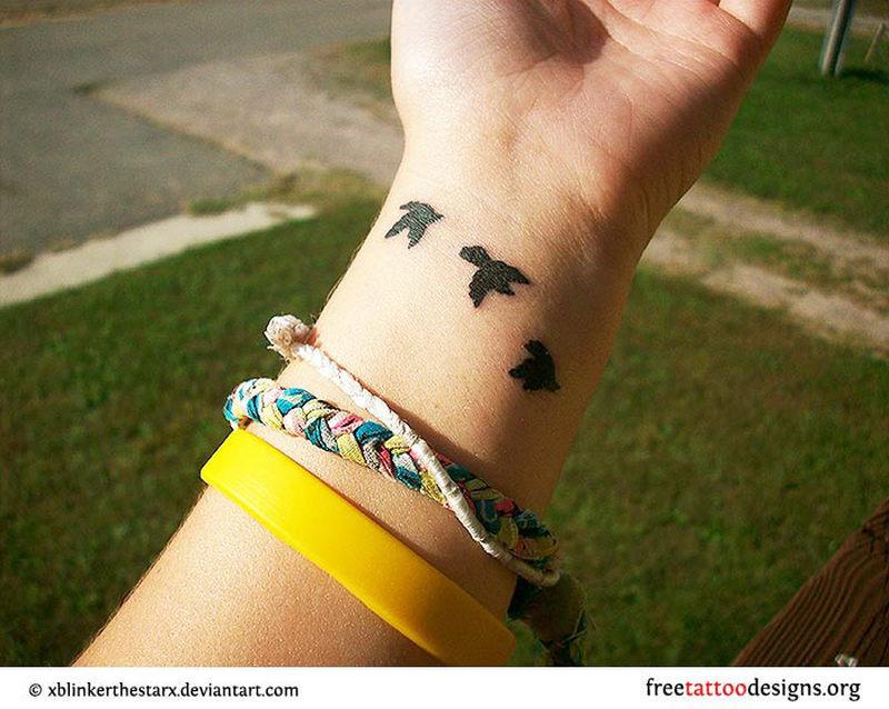 Cute birds tattoo on wrist