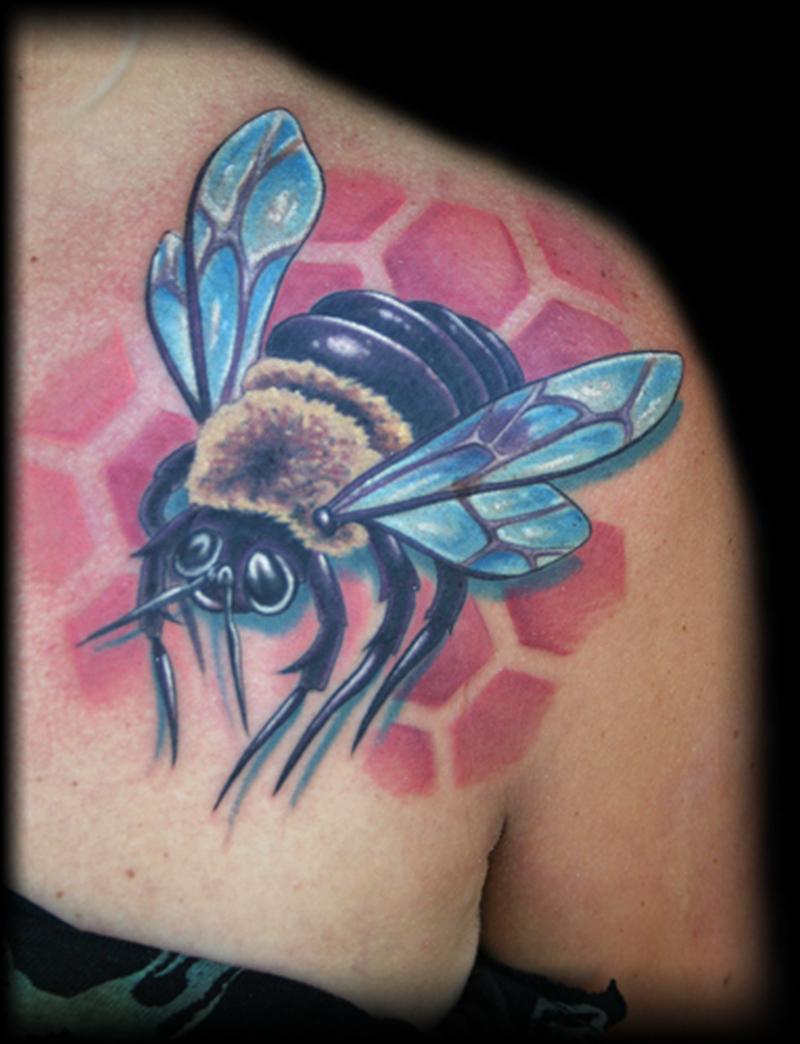 Cute bumblebee tattoo on back shoulder