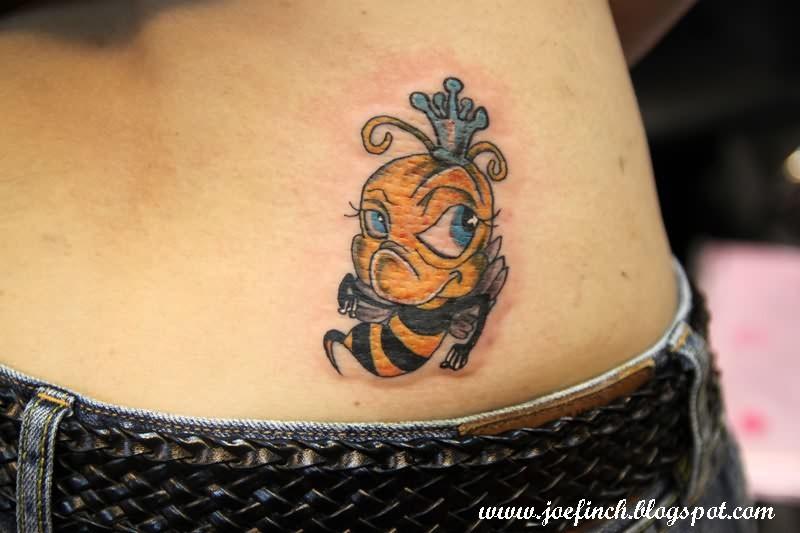 Cute bumblebee tattoo on lower back