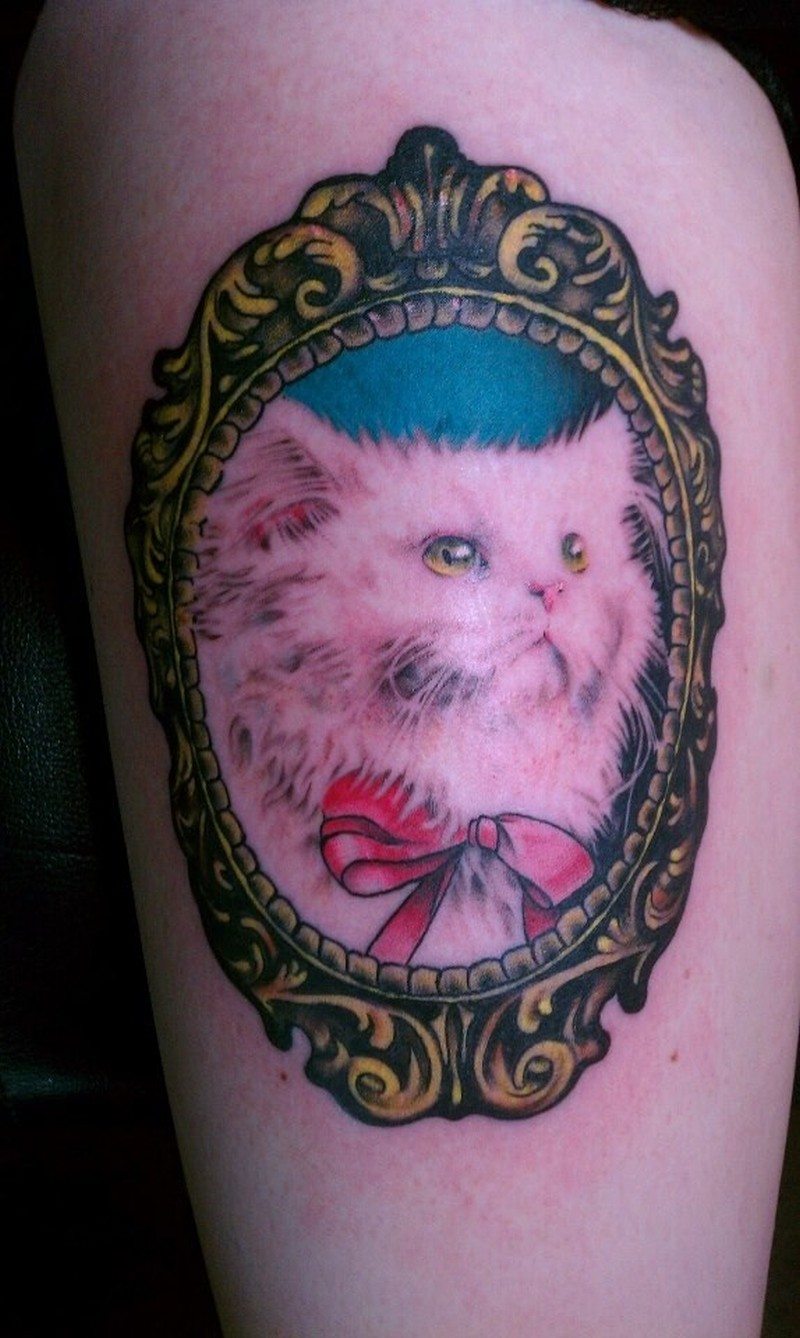 Cute cat in mirror tattoo design