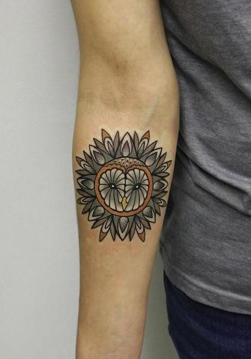 Cute coloured owl mandala forearm tattoo by Alice Cheked