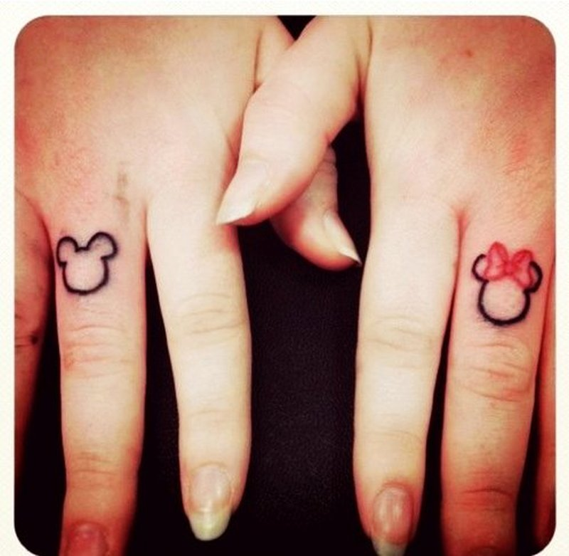 Cute couple tattoo design on fingers