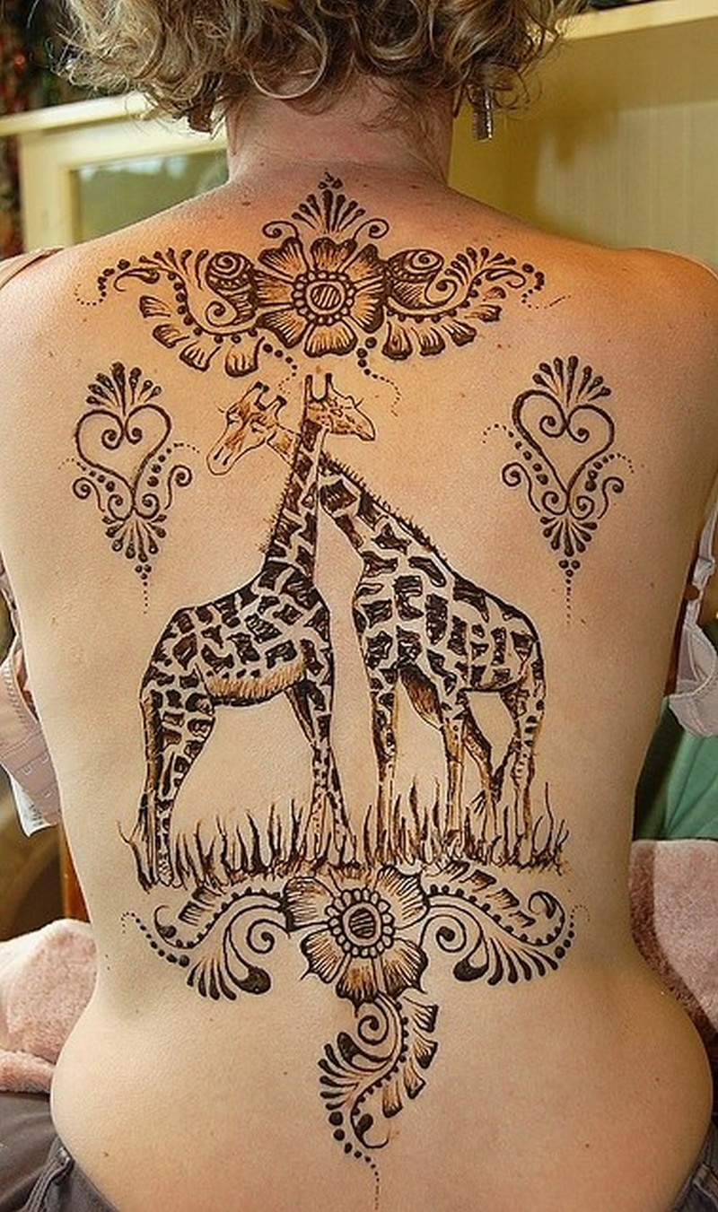 Cute giraffes with floral patterns tattoo on back