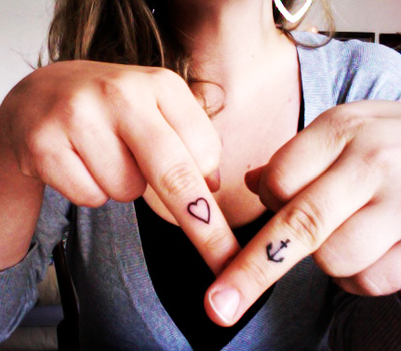 Cute heart anchor tattoo on fingers