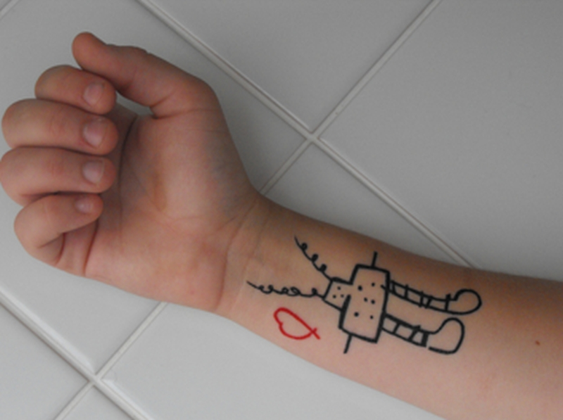 Cute heart n robot tattoo near wrist