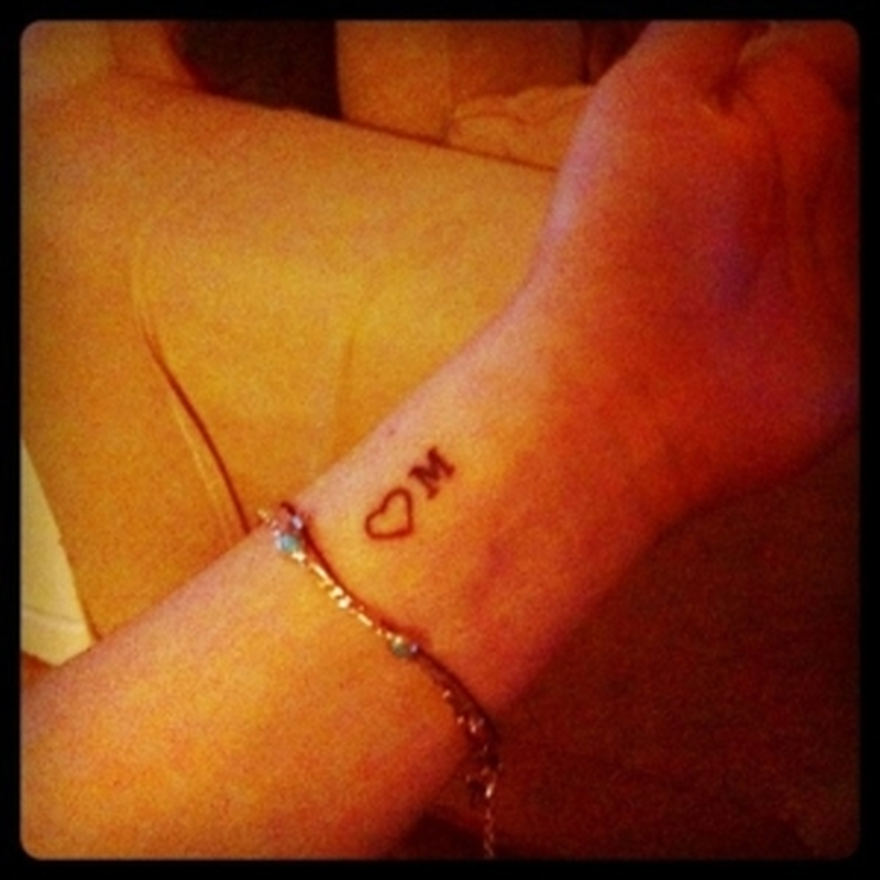Cute heart with initial tattoo on wrist