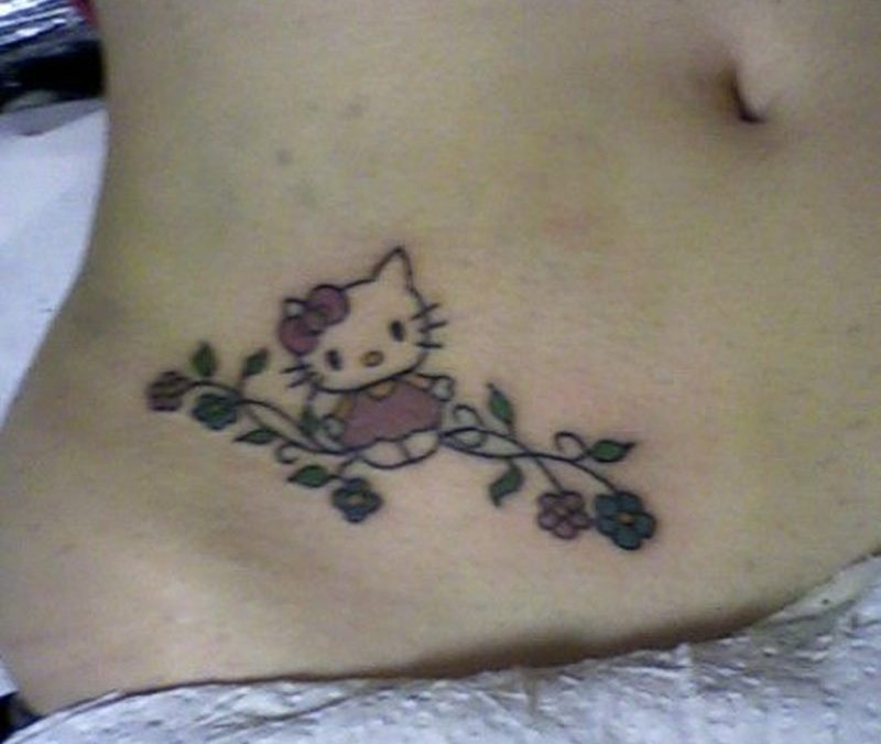 Cute hello kitty cartoon tattoo design on belly