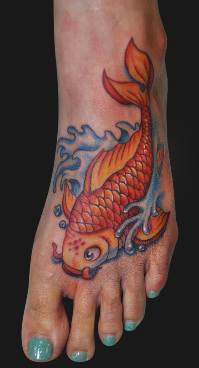 Cute koi fish tattoo on foot
