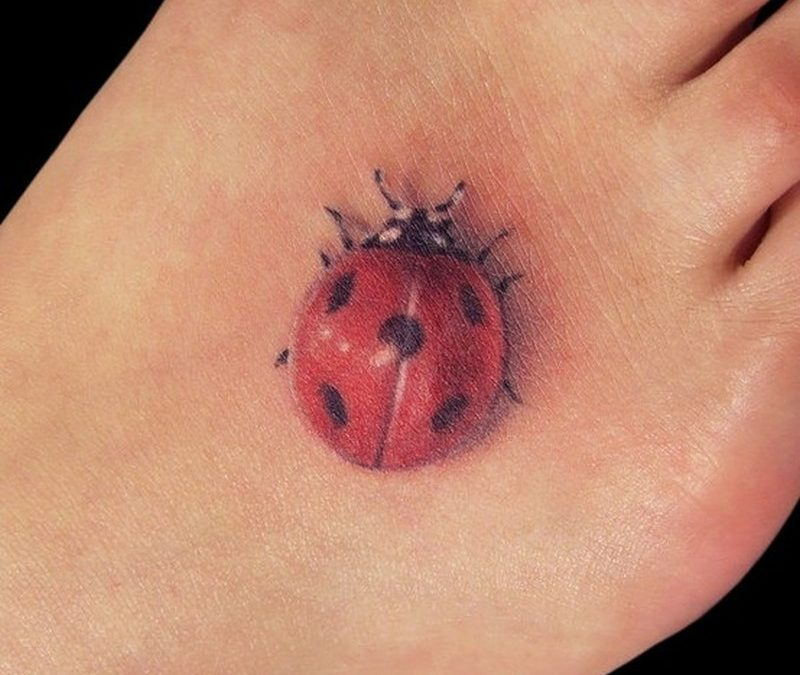 Cute lady bug tattoo for foot