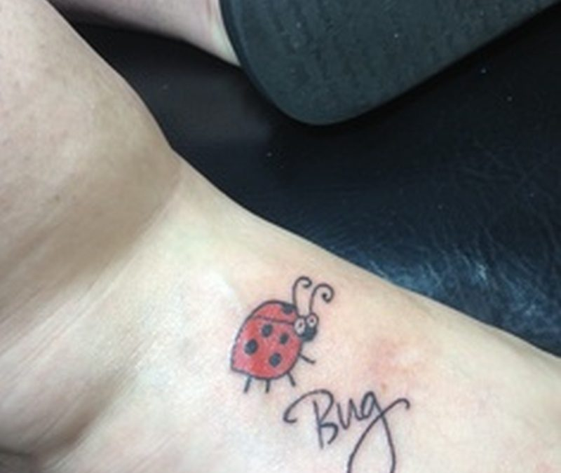 Cute lady bug tattoo on foot