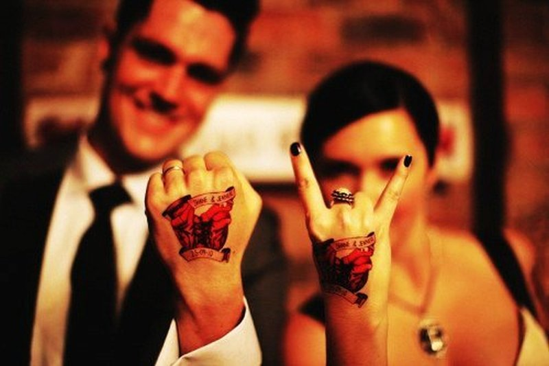 Cute matching couple tattoo on hands