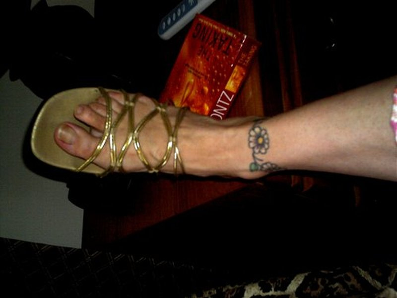 Daisy chain tattoo on ankle