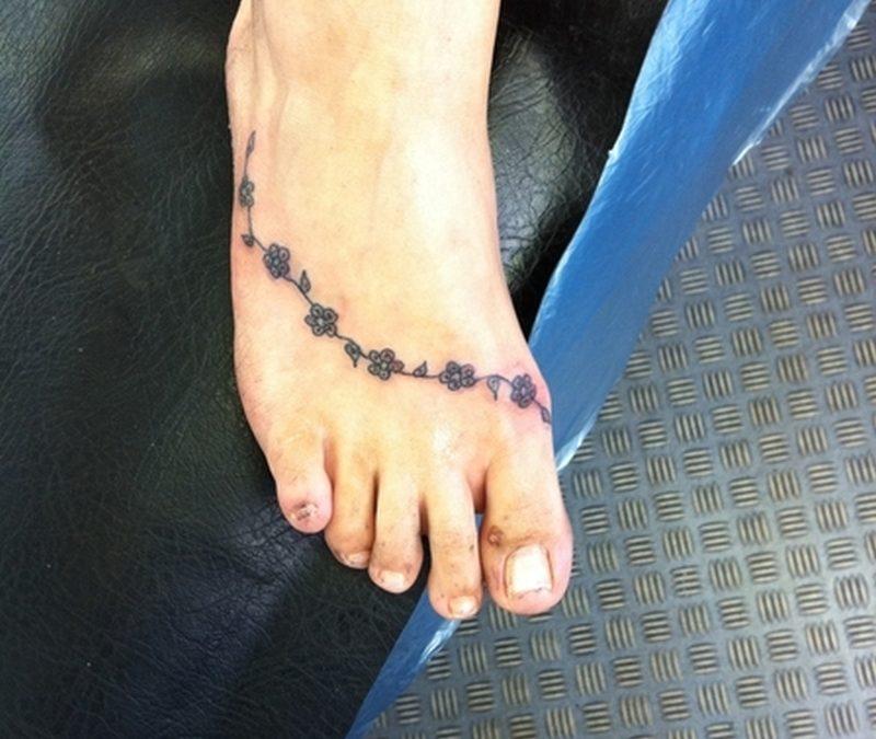Daisy chain tattoo on foot